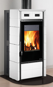 NORDICA-EXTRAFLAME modelo FUTURA 10  Kw Revestimiento exterior de mayólica  Wood stove with the possibility of automatic loading of the briquettes  Cajón de cenizas extraíble Colores: blanca infinity o negro brillante.